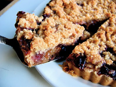 crumble tart with slice being taken out