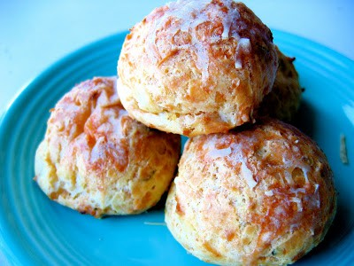 three gougeres on a plate