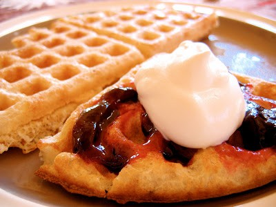 sourdough waffle topped with sour cream and berries