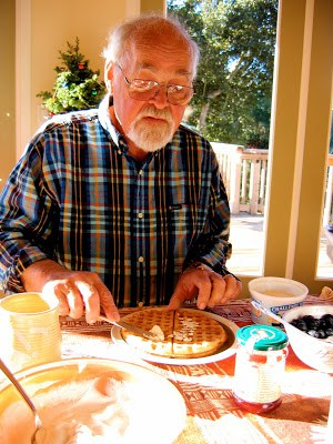 man enjoying a waffle