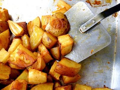 oven roasted potatoes and a spatula