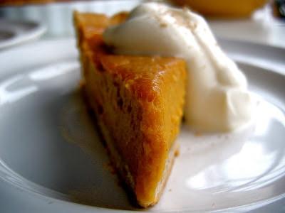 slice of pumpkin tart with cream on top