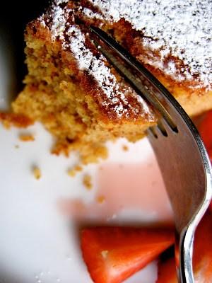 fork slicing through almond cake