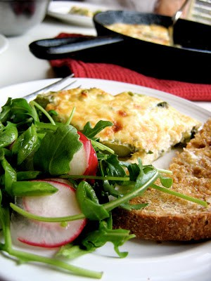 side shot of skillet quiche on a plate