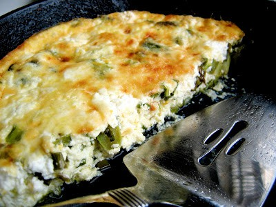 half of a skillet quiche in a pan
