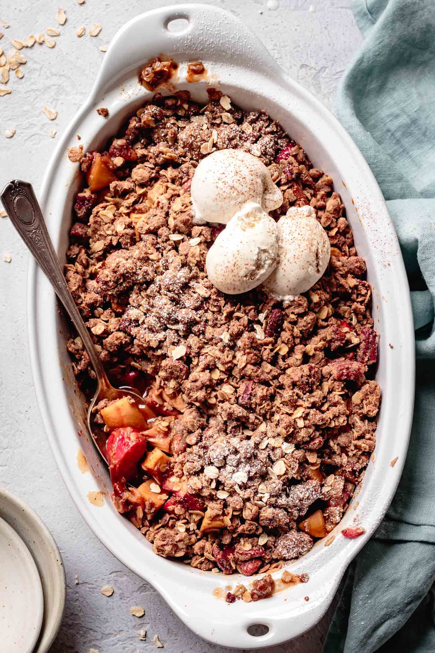 vegan gluten-free apple rhubarb crisp topped with ice cream