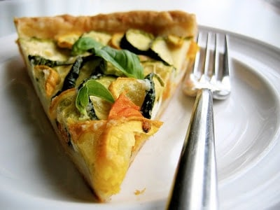 slice of zucchini and tomato tart on a plate