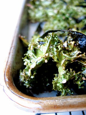 corner of baking tray with kale chips in it