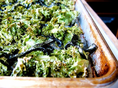 baking tray with kale chips in on it