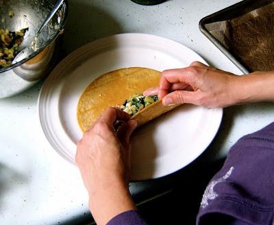 rolling enchiladas