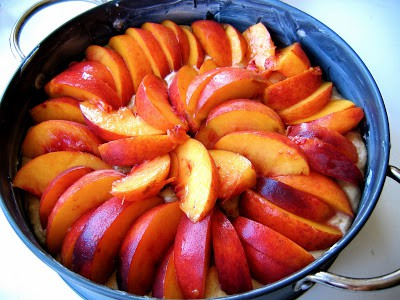 slices of peach on top of ckae