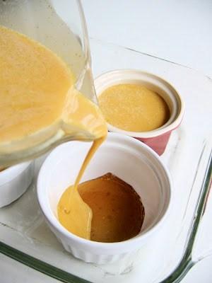 pumpkin mix being poured into a ramikin