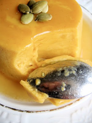 close up of pumpkin flan and spoon