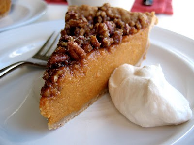 pecan topped pie on a plate