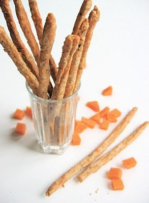 a glass full of cheese straws