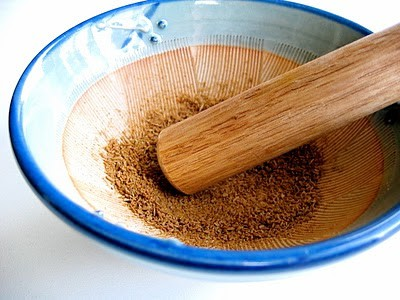 spices being crushed in a bowl