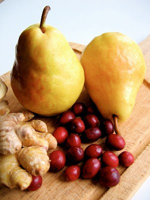 pears and cranberries on a board