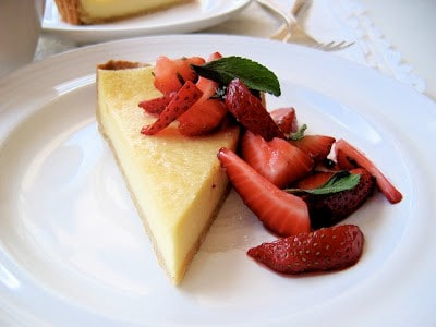 slice of lemon mascarpone tart on a plate with strawberries