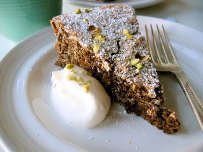 slice of pistachio chocolate torte on a plate