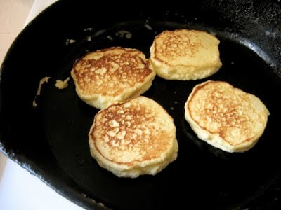 ricotta pancakes cooking in a skillet