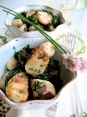 roasted turnips with wilted turnip greens in a bowl
