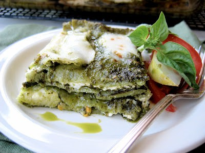 slice of zucchini pesto lasagna on a plate with fork