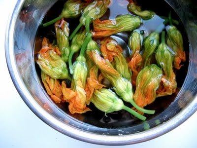 squash blossoms in ice water