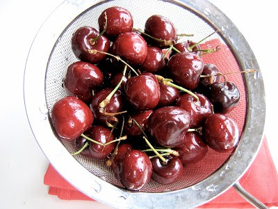 cherries in a sieve