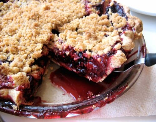 berry crumble with slice taken out
