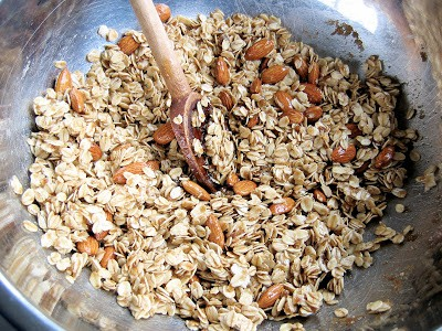 oats and nuts in a bowl being stirred