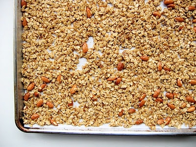top down shot of granola on baking tray
