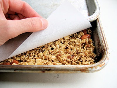 granola between two baking trays