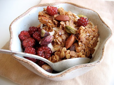 bowl of honey granola and spoon