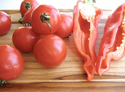 tomatoes and pepper on a chopping board