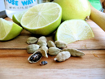 lime and cardamom seeds on a chopping board