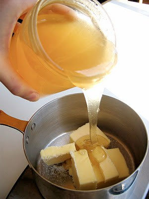 honey poured onto butter in a pot