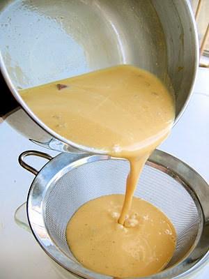 ice cream mix poured through a sieve