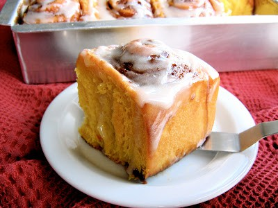 pumpkin spice cinnamon roll on plate