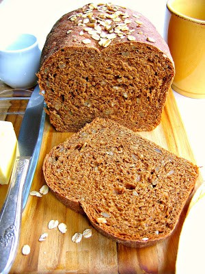 loaf and slice of oatmeal molasses bread