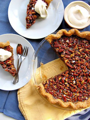 top down shot of pecan pie and slices on plates