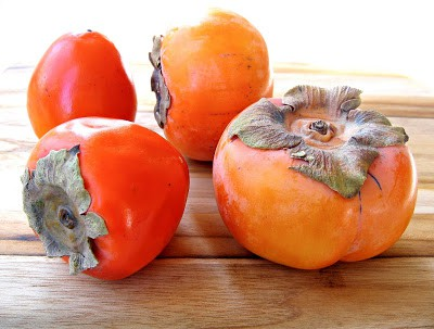 persimmons on a table