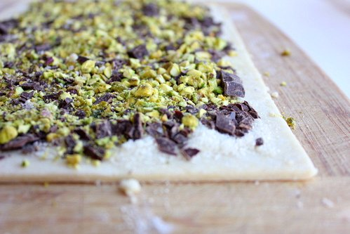 chopped nuts and chocolate on pastry sheet