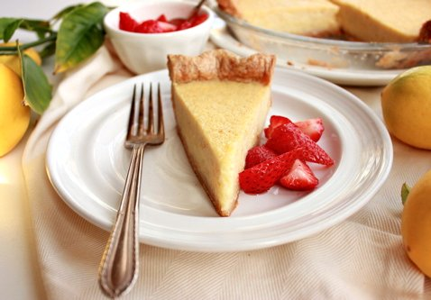slice of lemon pie with a fork