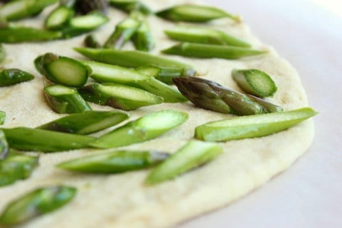 close up of asparagus on a pizza