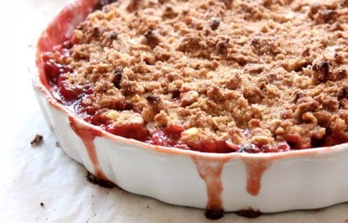 gluten free strawberry rhubarb crumble baked in a white dish