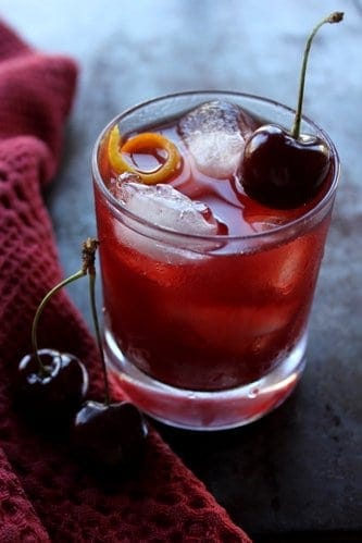 glass of sweet cherry manhattan