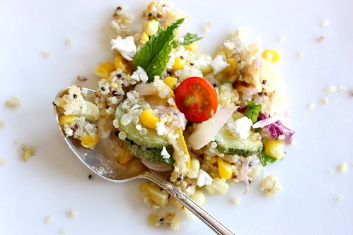 quinoa corn salad with a spoon