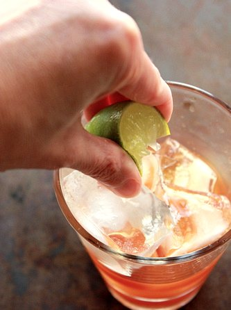 lime squeezed into dark and stormy