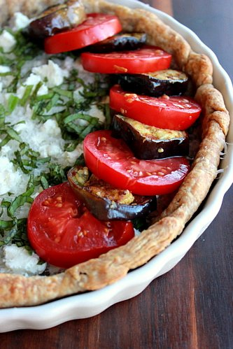 close up of tomatoes on tart
