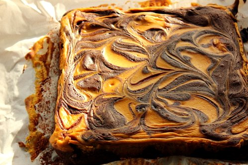 a slab of gluten free cheesecake brownies